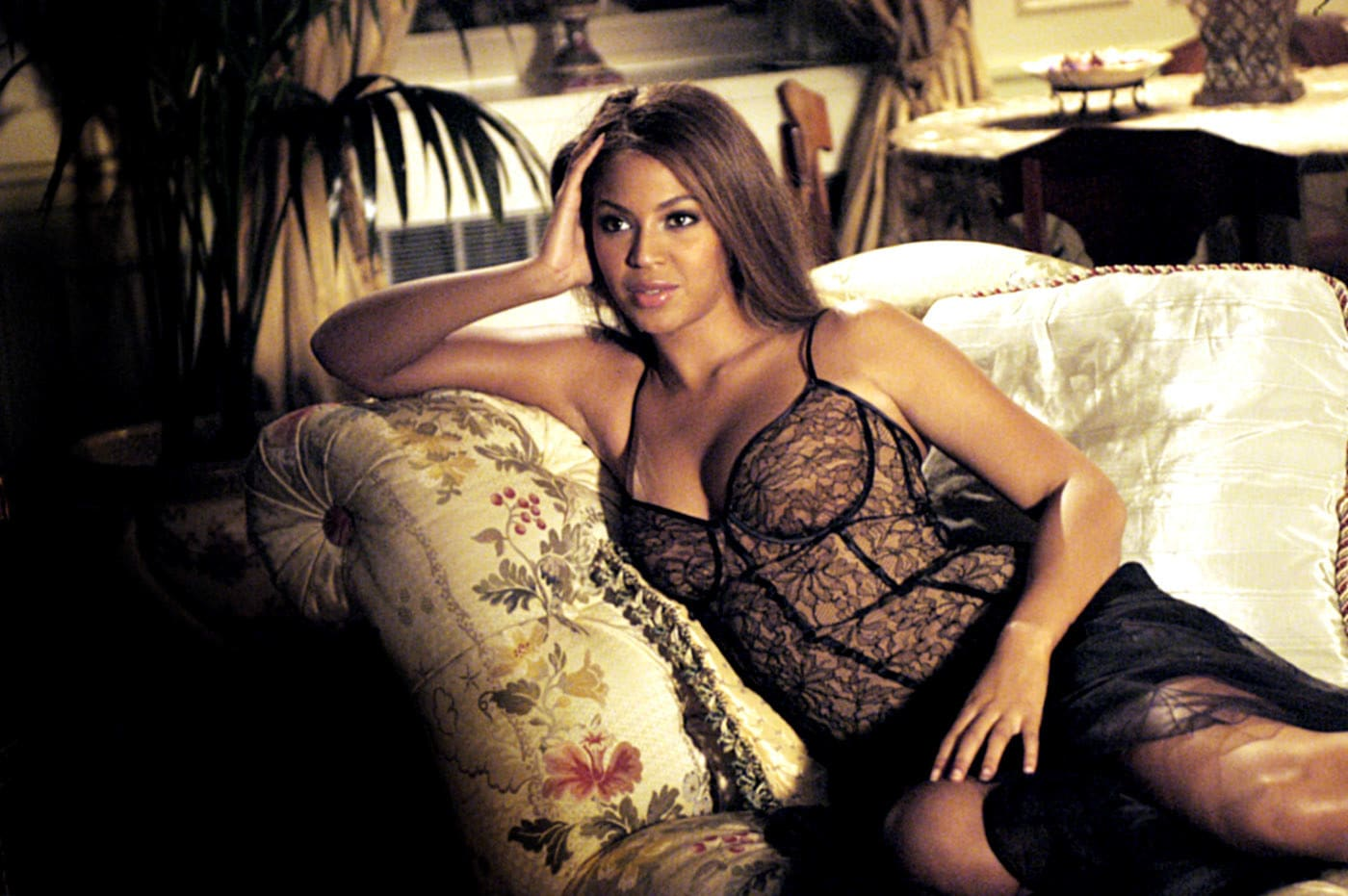 """Beyonce lounging on a chaise in """"The Pink Panther"""""""