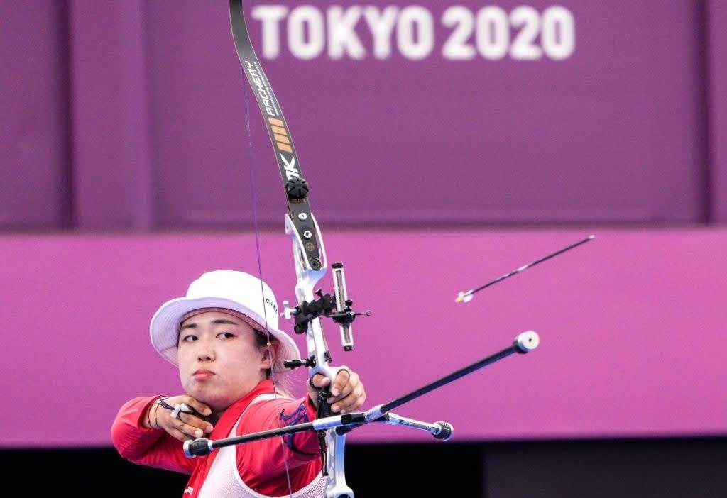 An archer releasing an arrow from their bow