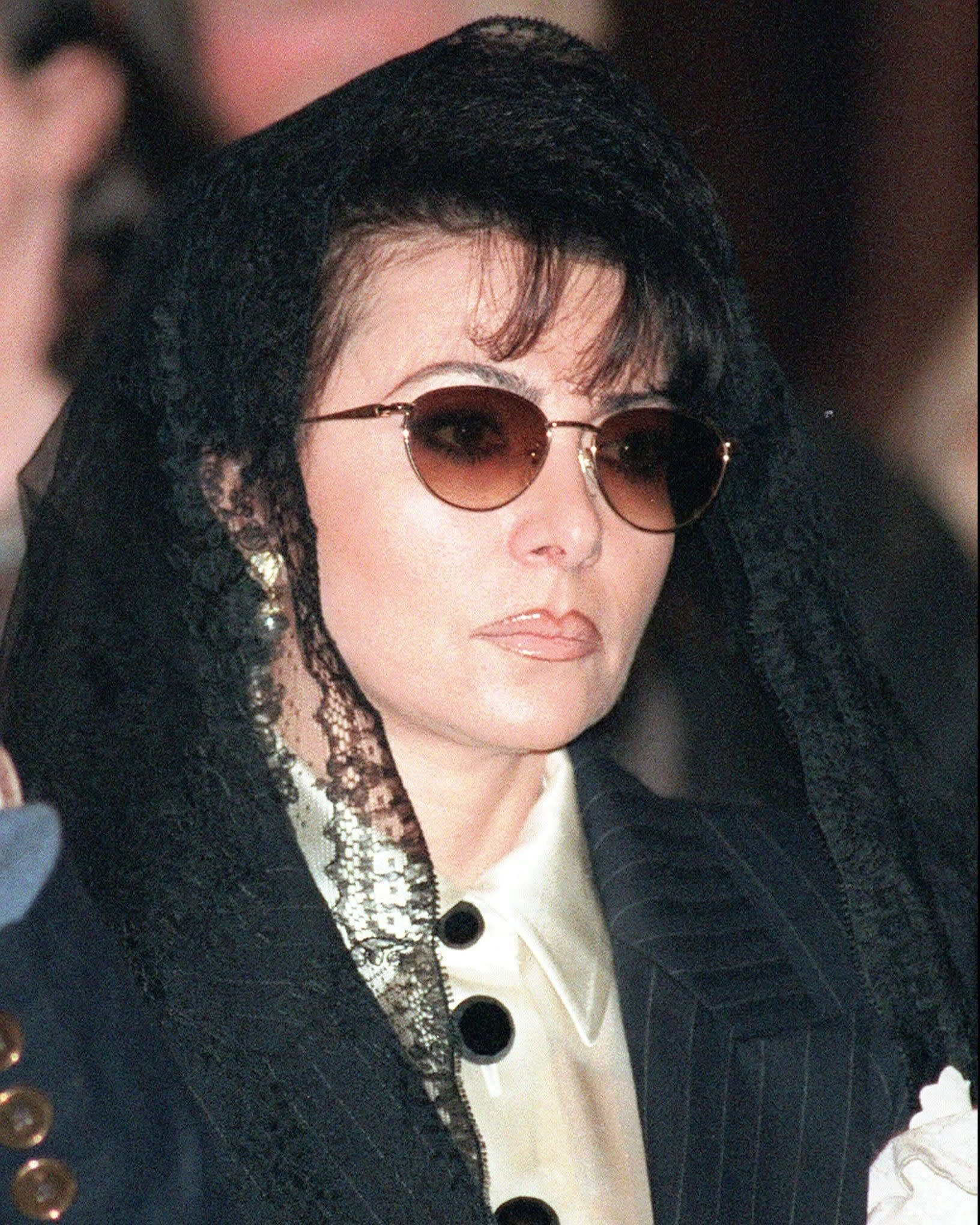 Lady Gaga wearing a veil over her head and sunglasses