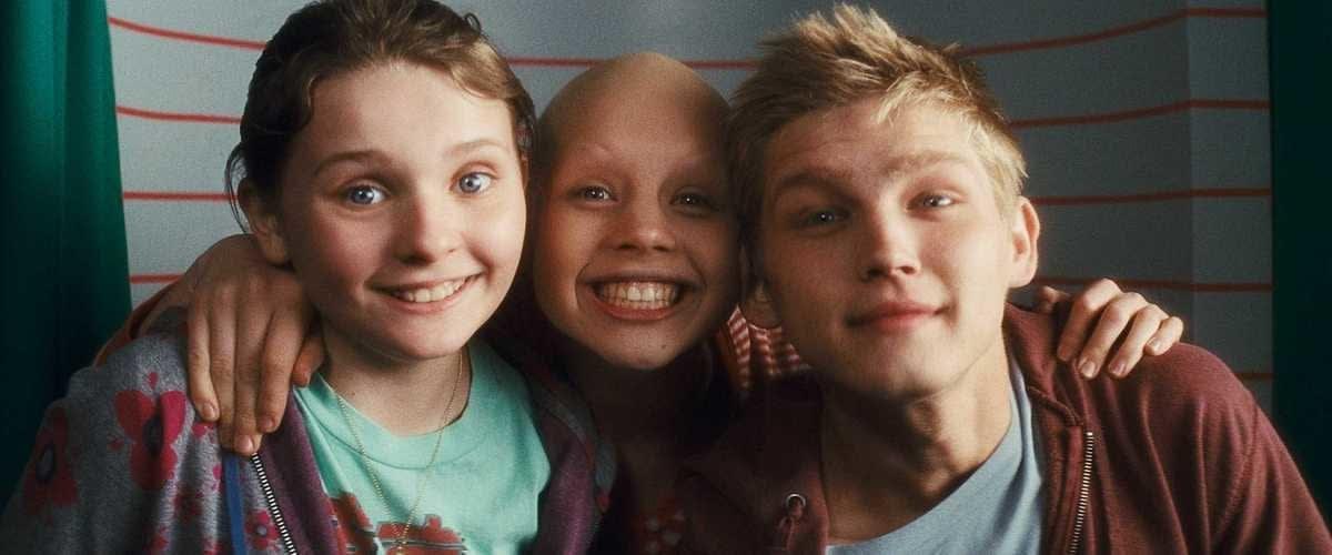 Imagem dos três atores mirins do filme Uma Prova de Amor.