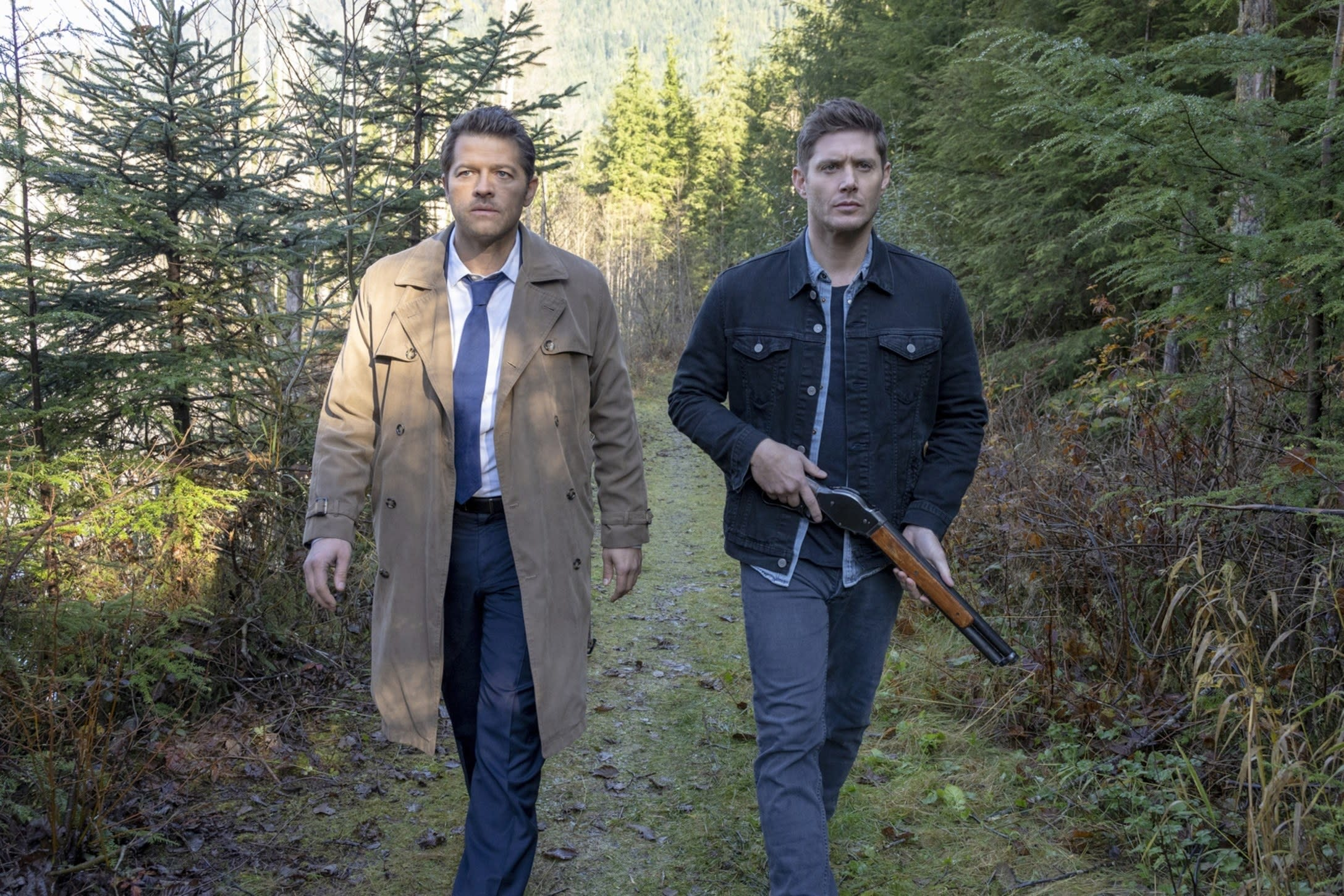 """Misha Collins in a trench coat next to Jensen Ackles on """"Supernatural"""""""