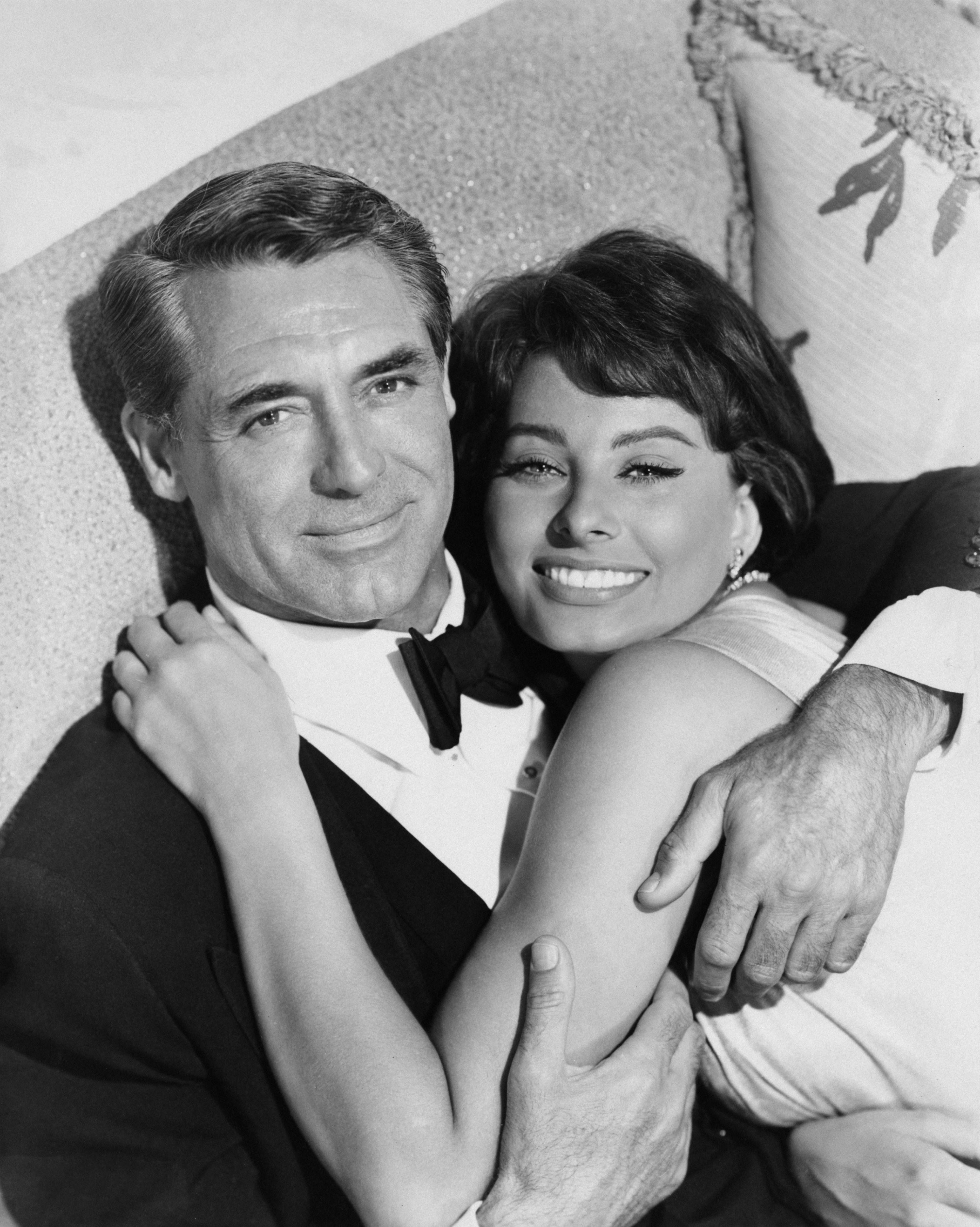 """Grant and Loren posing for a still for """"Houseboat"""" in 1958"""