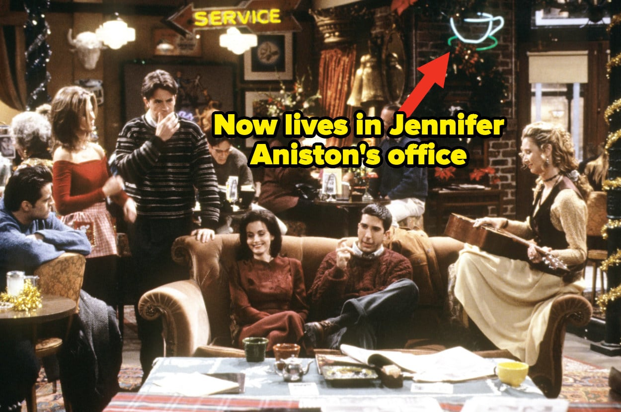 """The cast of """"Friends"""" in Central Perk with an arrow pointing out a sign in the background that Jennifer Aniston owns"""