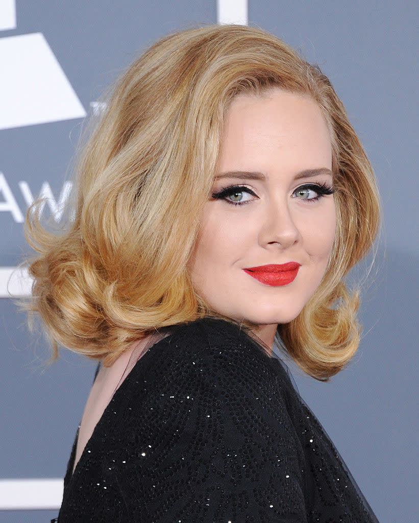Adele poses on the red carpet at 54th Annual Grammy Awards