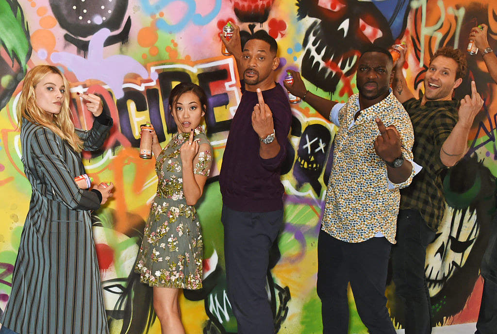 """(L to R) Margot Robbie, Karen Fukuhara, Will Smith, Adewale Akinnuoye-Agbaje, Jai Courtney and the cast of """"Suicide Squad"""""""