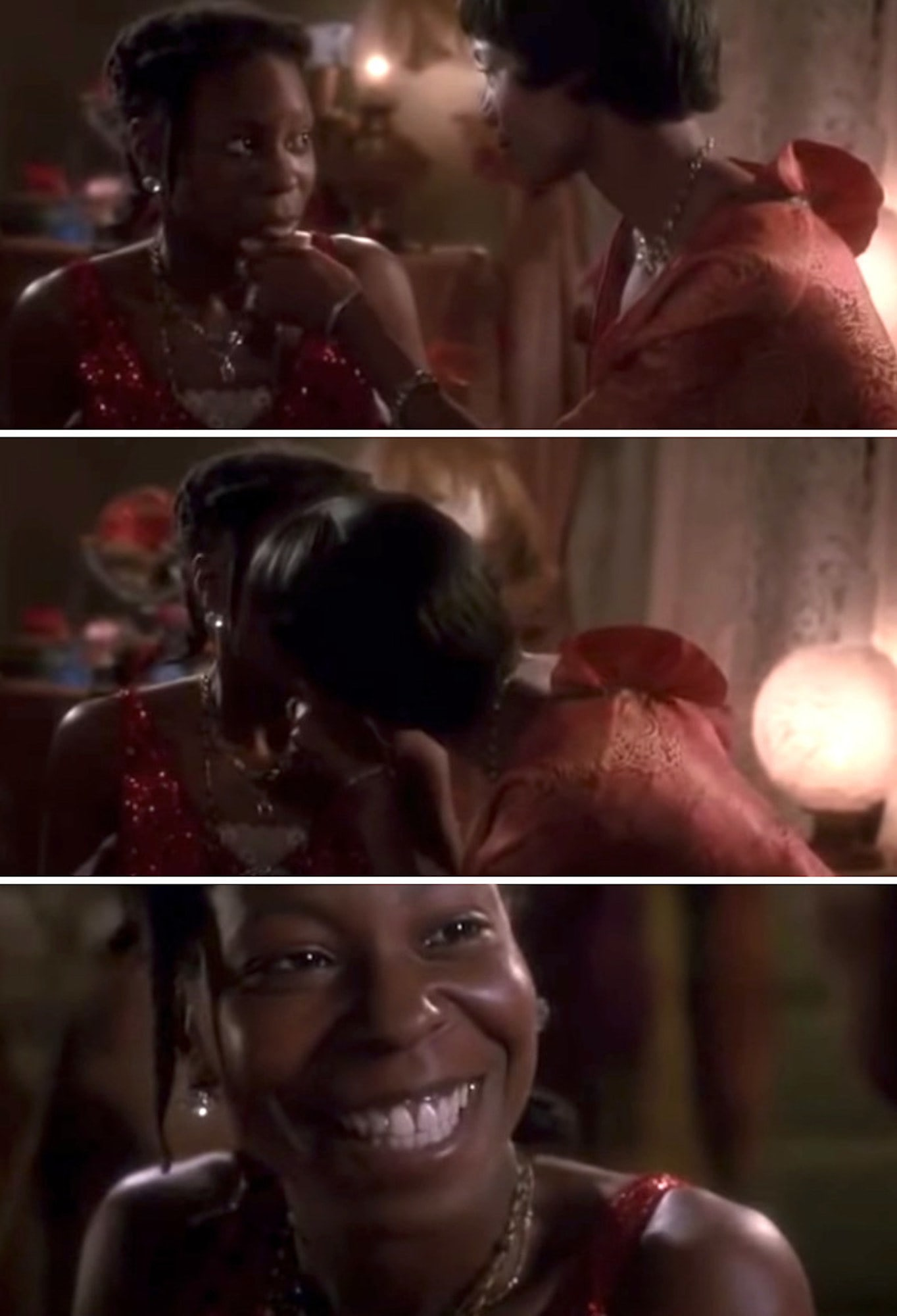 Shug kissing Celie for the first time, and Celie smiling happily in response