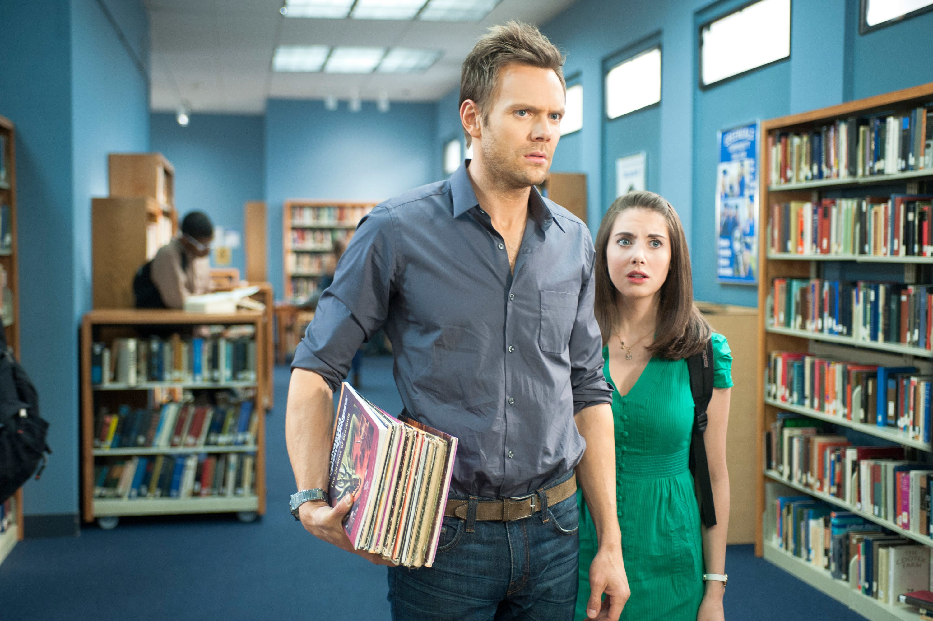 Joel McHale and Alison Brie in a Community College library