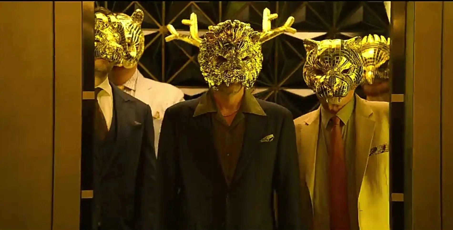 VIPs in golden animal masks.
