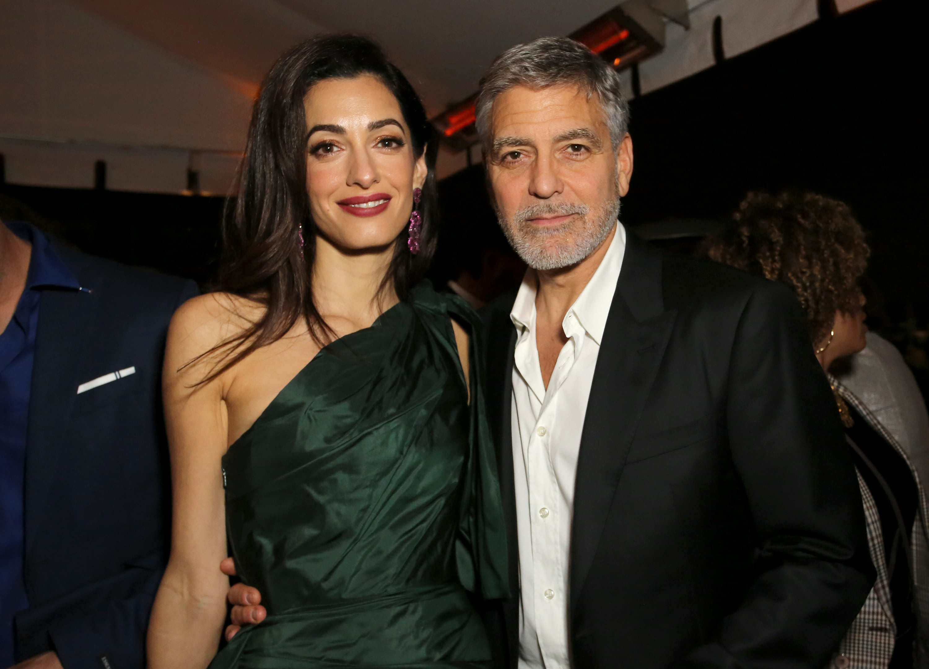 George and Amal pose together