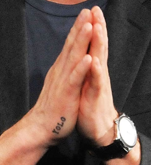 YOLO hand tattoo close-up