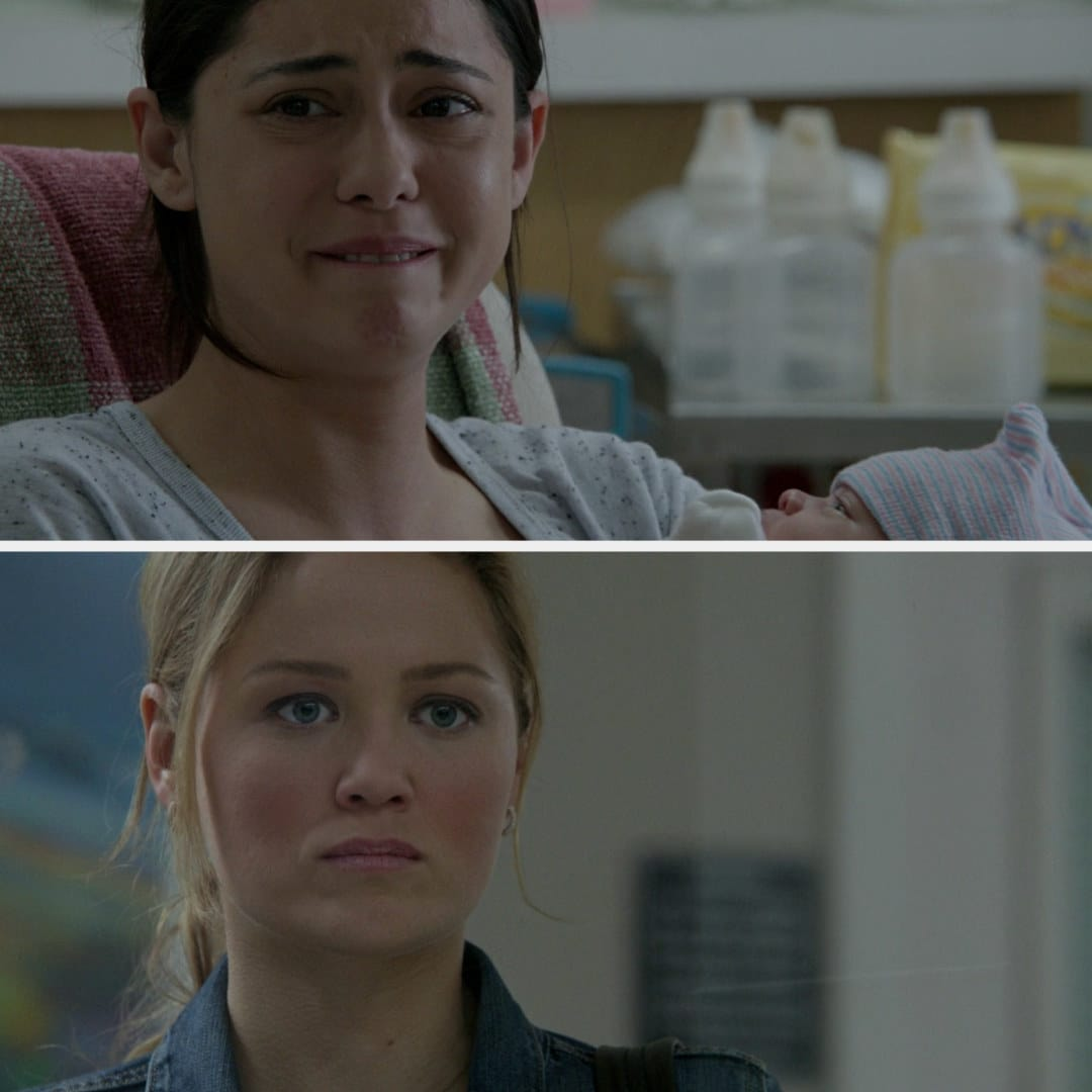 Julia looking upset as she sees Zoe holding the baby and crying