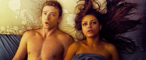 """Justin Timberlake and Mila Kunis laying next to each other after sex in """"Friends With Benefits"""" and the sheet is pulled up over Mila's chest, but not Justin's"""