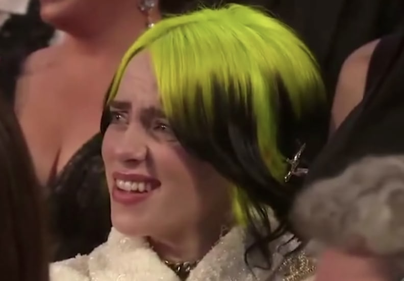 Billie at an awards show with her hair dyed green and black