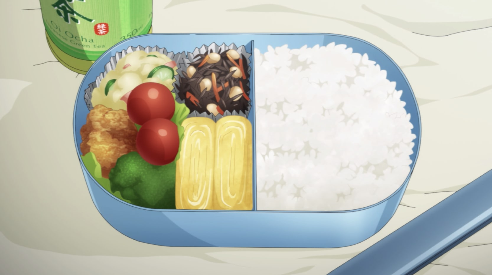 A bento; this one is filled with rice, an omelette, a salad and some other sides