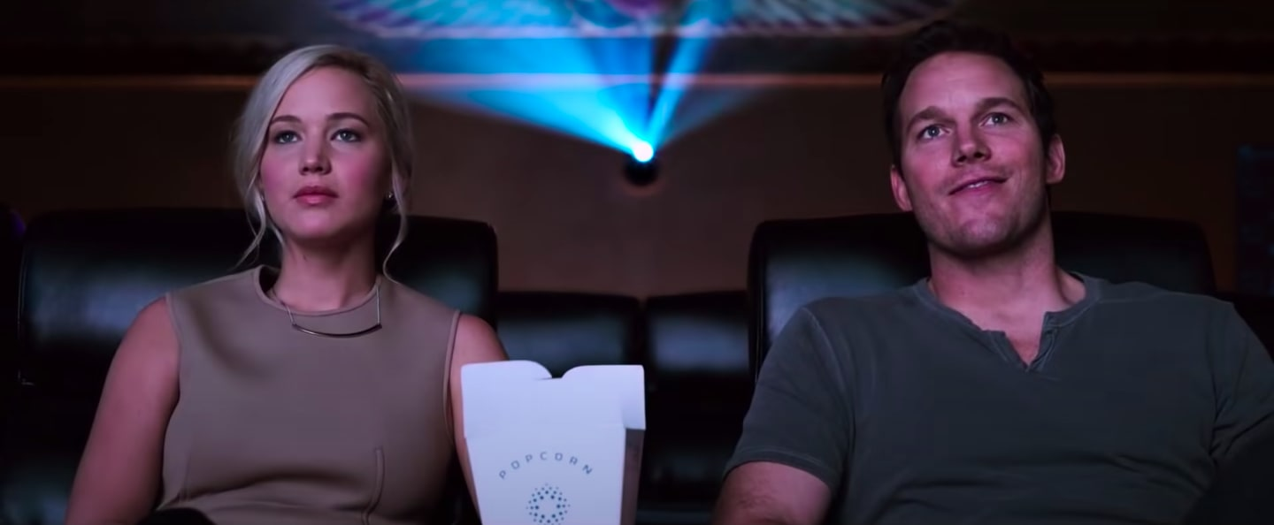 "Aurora and Jim watching a movie in ""Passengers"""