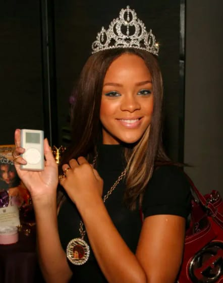 rihanna holding an ipod mini