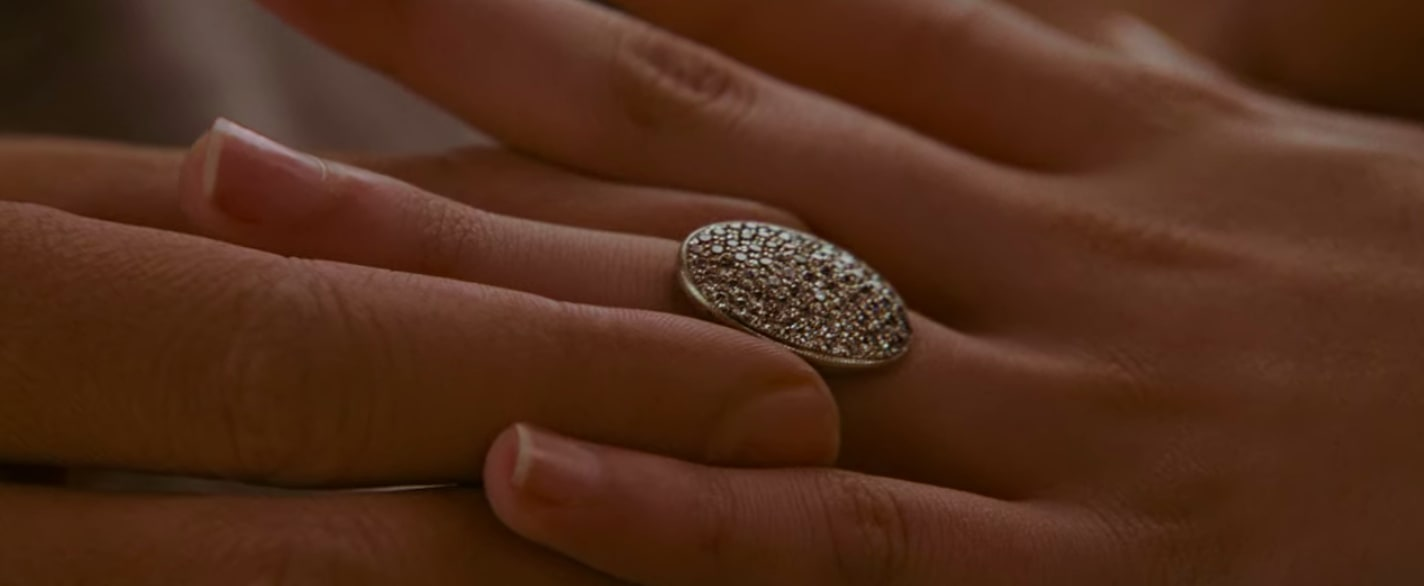 Edward sliding the engagement ring onto Bella's hand