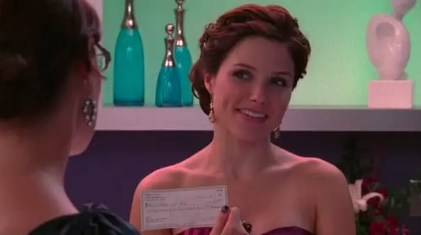 """Brooke holding up the check Millie wrote her on """"One Tree Hill"""""""