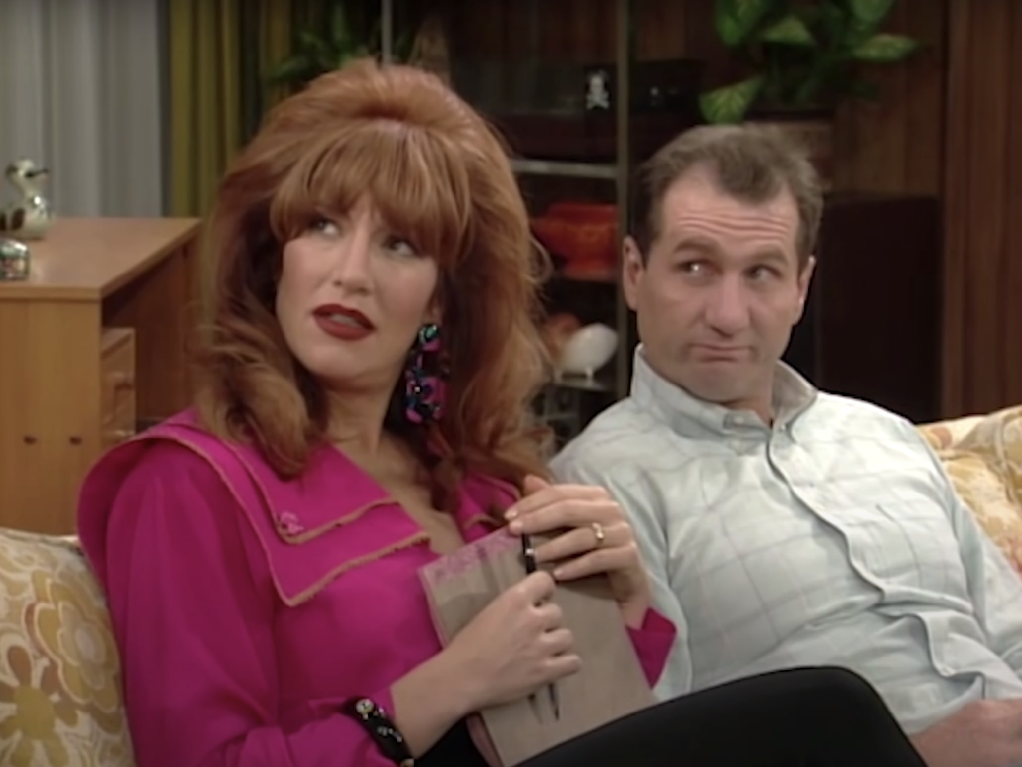 Al Bundy and Peggy sitting on the couch