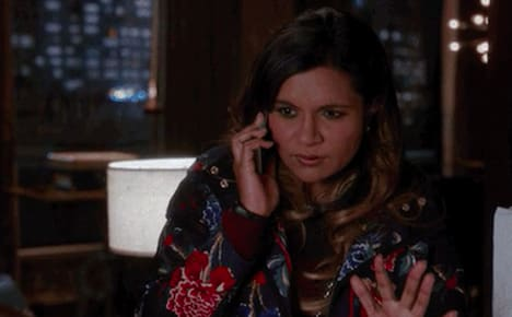 """Mindy Kaling on """"The Mindy Project"""" talking on the phone and looking confused"""