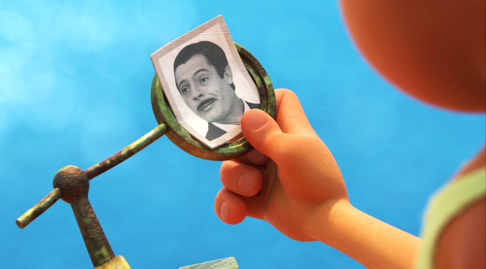 A boy looks at a photo