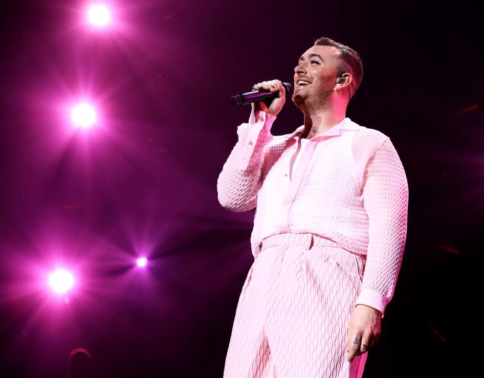 Sam Smith singing onstage in an all-pink outfit