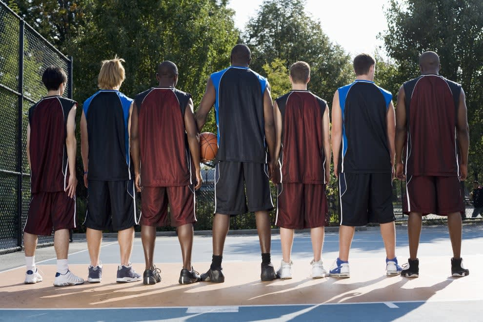 a lineup of tall basketball players