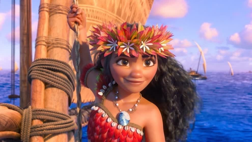 moana stands on a boat while on the ocean