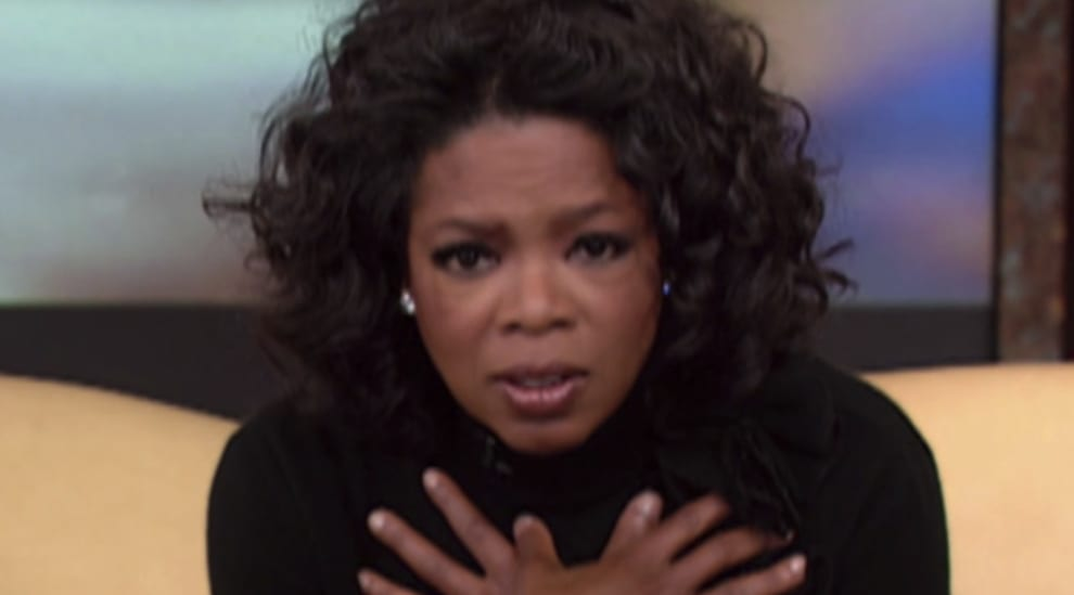 Oprah looking concerned but intrigued