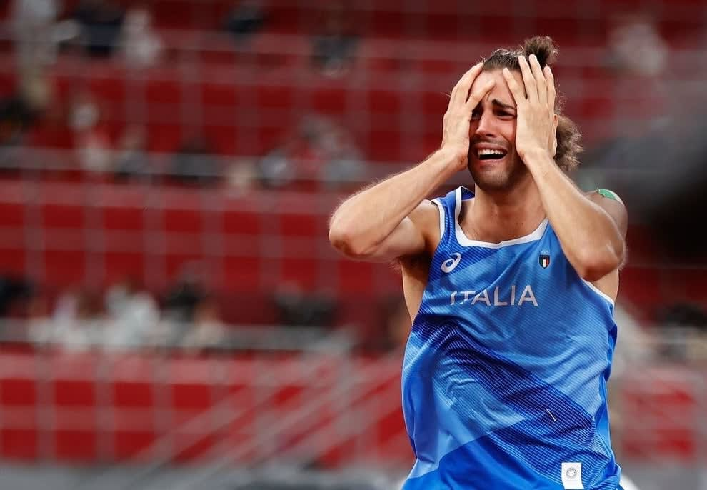 Gianmarco holds his hands to his head in disbelief