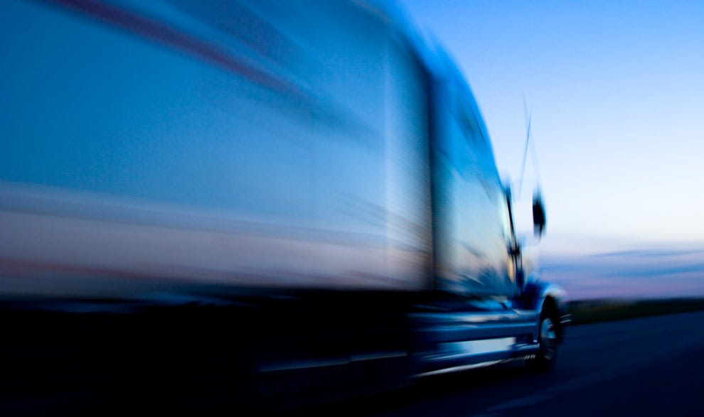 A truck driving rapidly