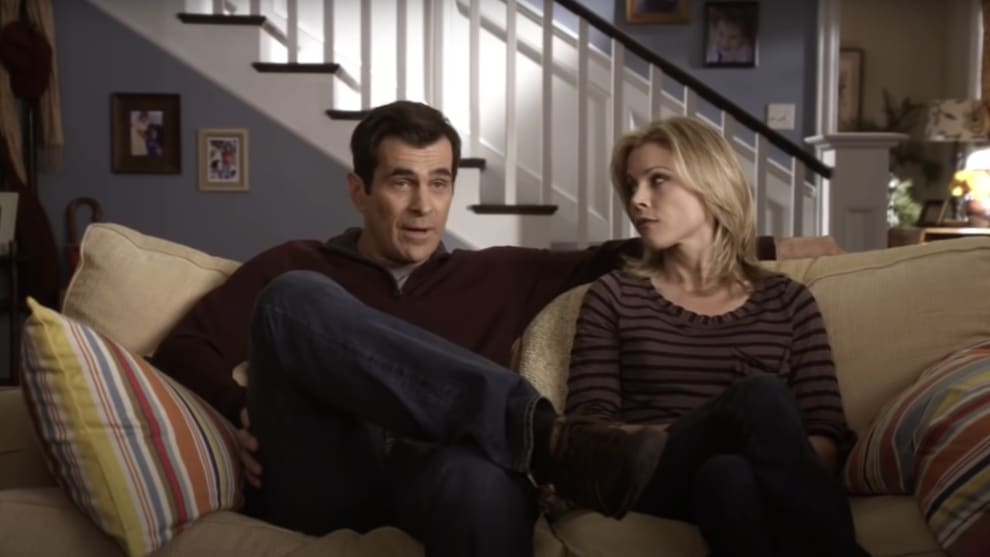 Phil and Claire sitting on the couch