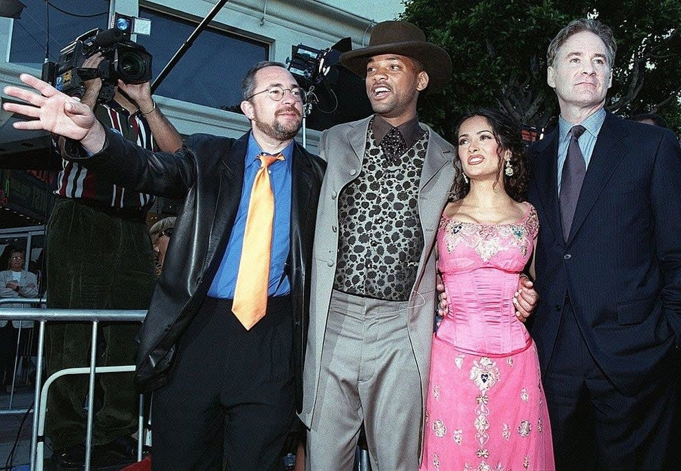 """Barry Sonnenfeld(L), Will Smith, Salma Hayek, and Kevin Kline arrive at the premiere of the film """"Wild Wild West"""""""