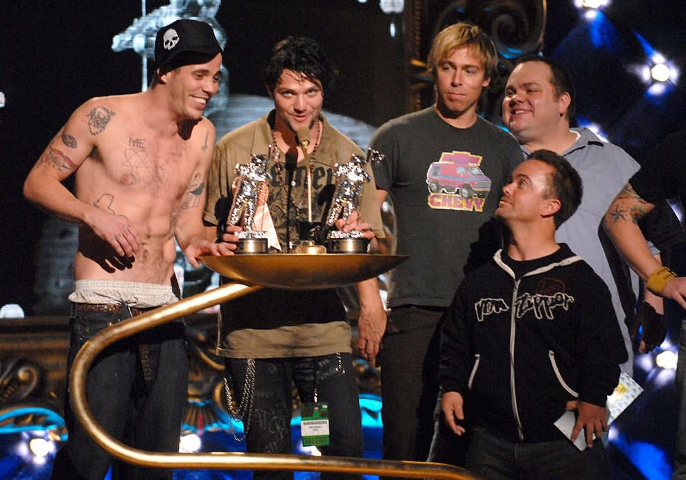 The castmembers on stage at an awards show