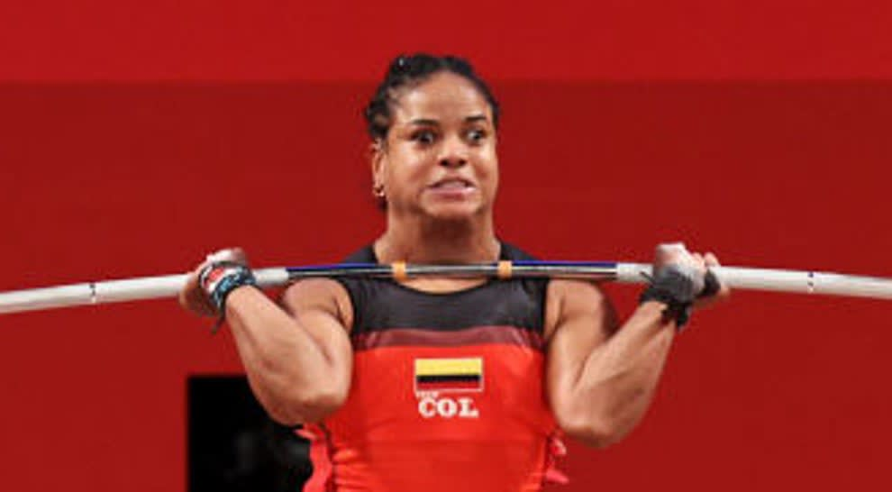 This weightlifter has a strained face as they attempt a lift