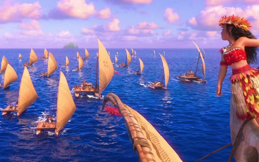 moana stands on a boat on the ocean