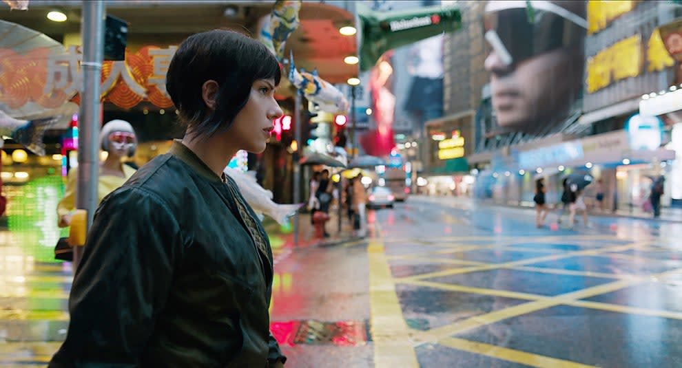 Scarlett Johansson, who plays a Japanese character, walks through the streets of Tokyo