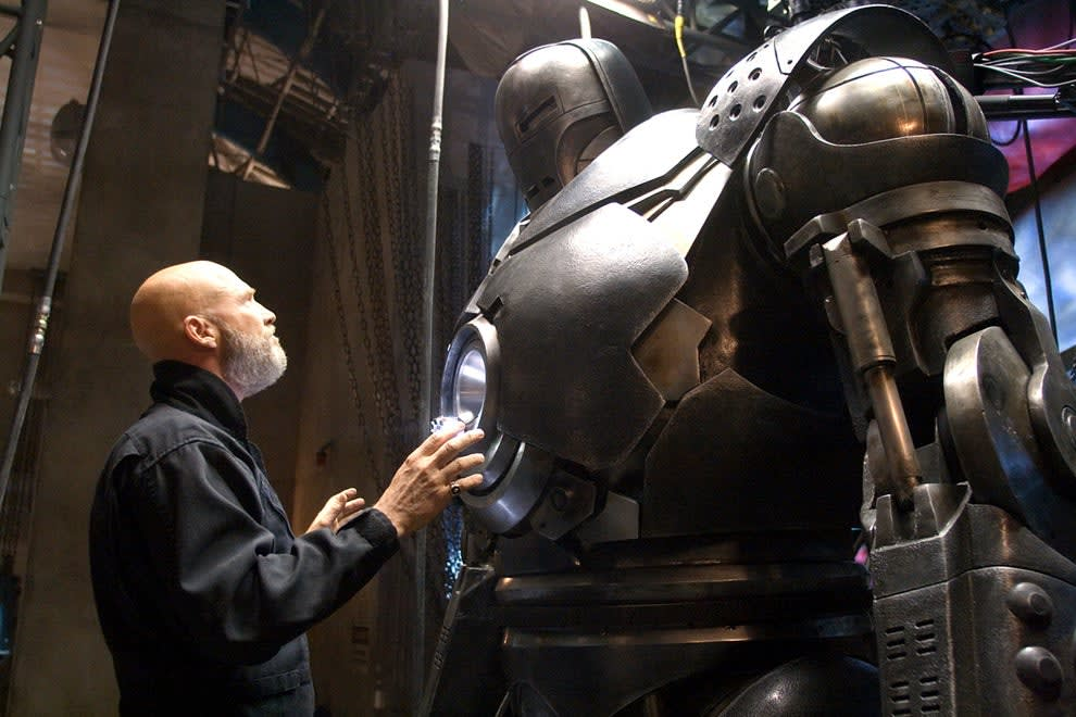 Obadiah looking at the Iron Monger suit