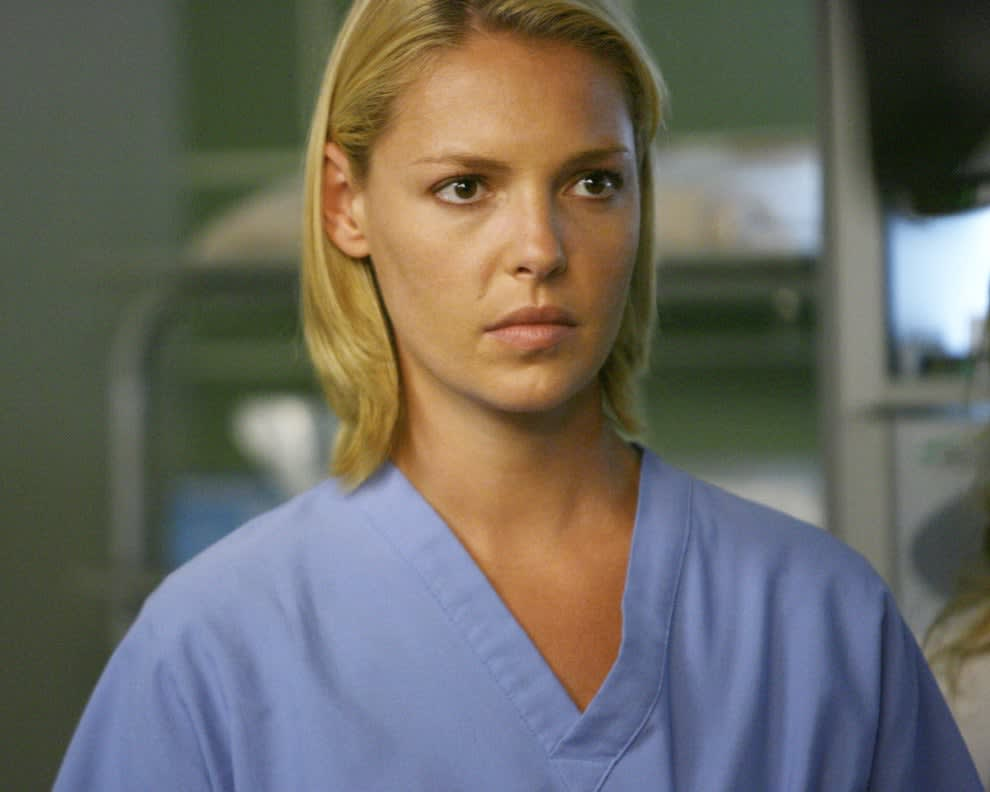 Heigl looks concerned while wearing scrubs