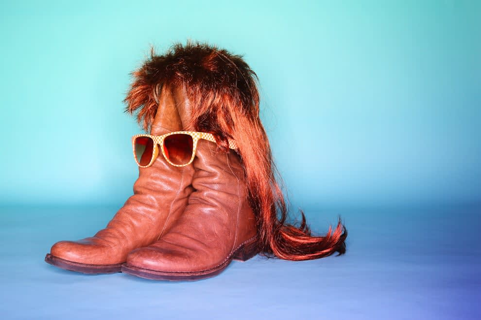 boots with a mullet and sunglasses