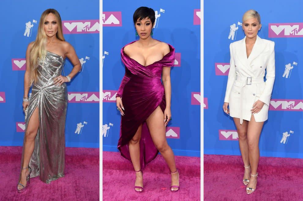 JLo wears a metallic one-shoulder gown, Cardi B wears an off-the-shoulder velvet dress, and Kylie wears a structured blazer dress