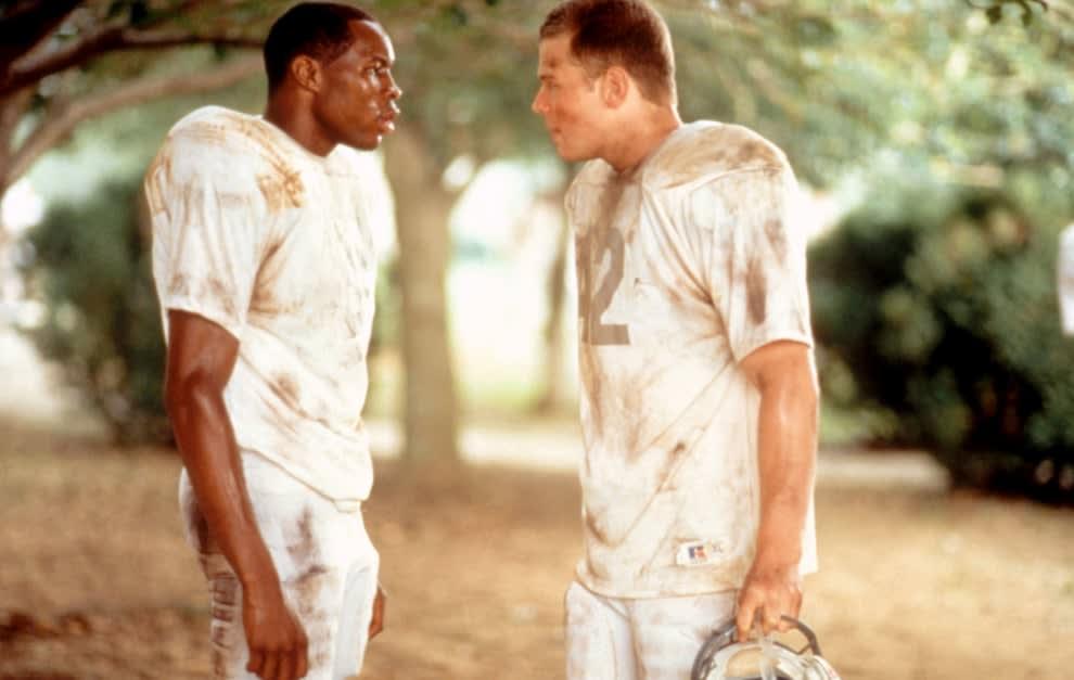 Wood Harris andRyan Hurst in football uniforms