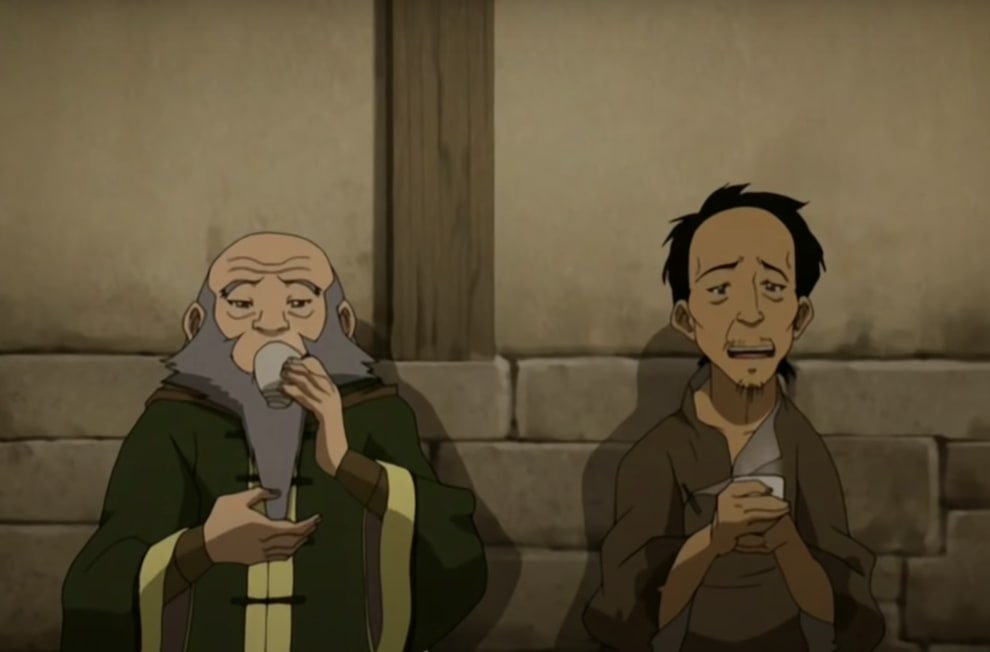 Iroh and a man who earlier tried to mug him drinking tea together