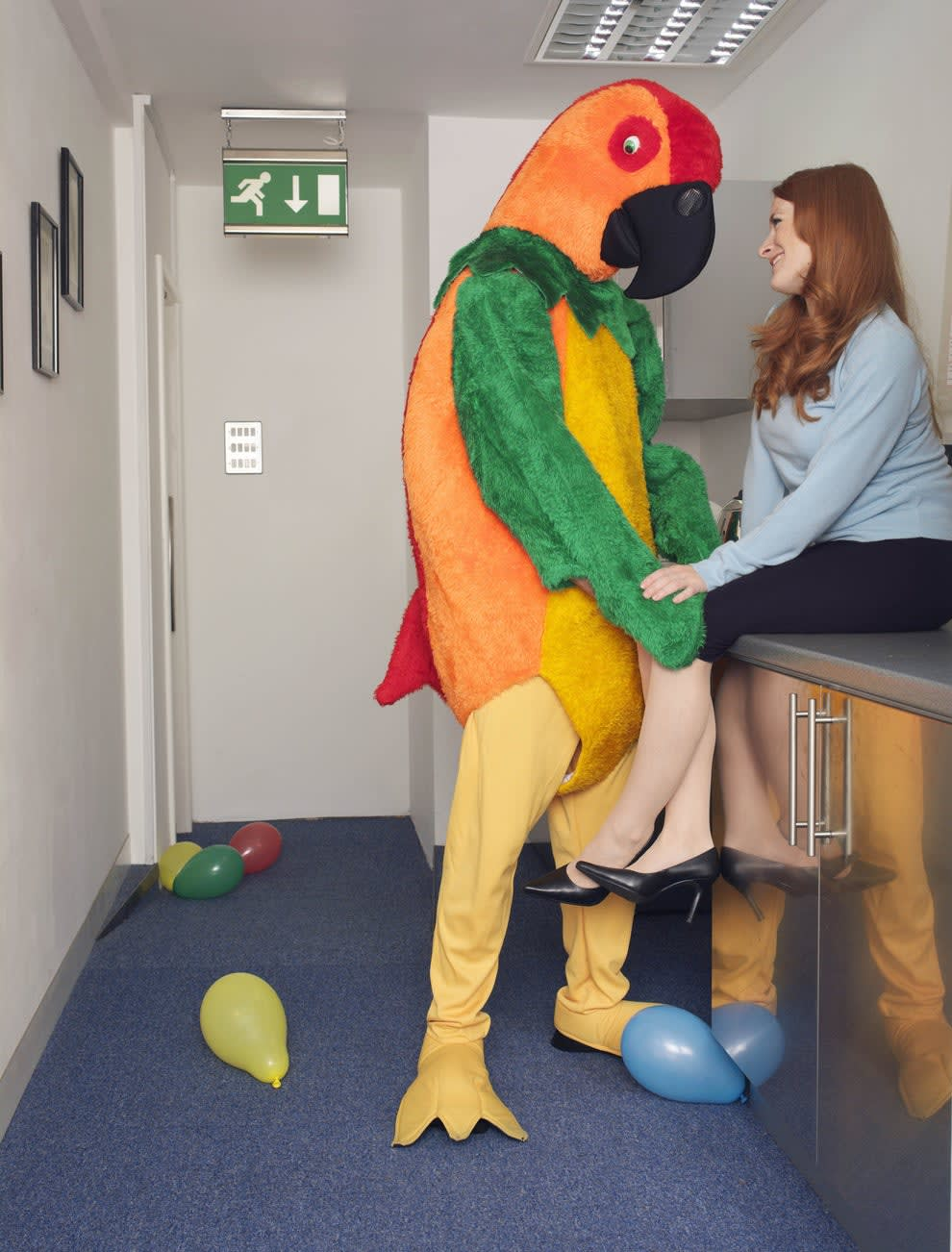 person in a parrot costume flirting with a woman