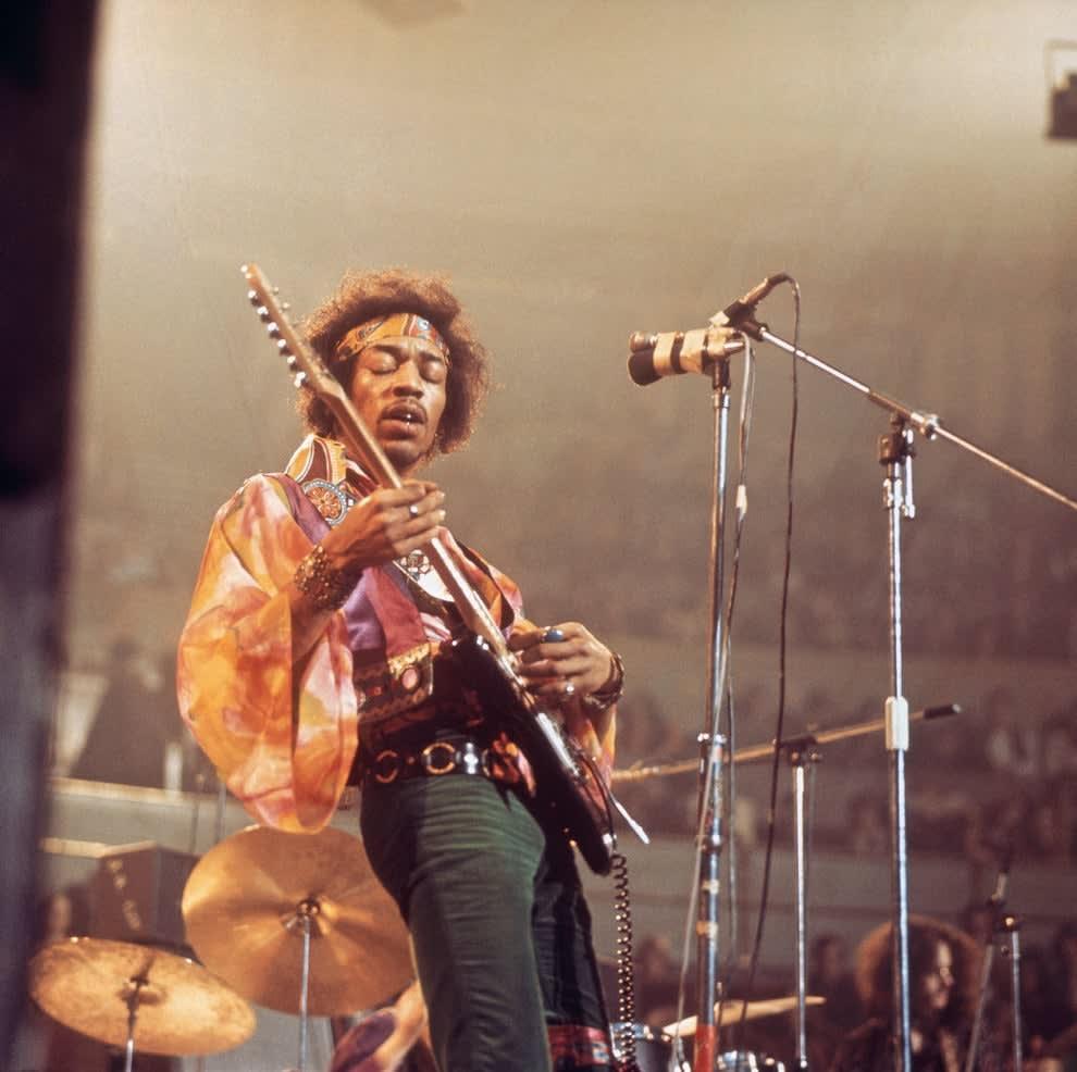 Jimi Hendrix playing guitar at the Royal Albert Hall in 1969