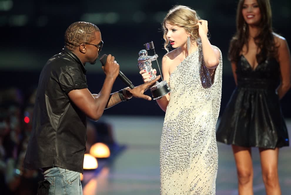 Kanye interrupting Taylor, who's holding her VMA