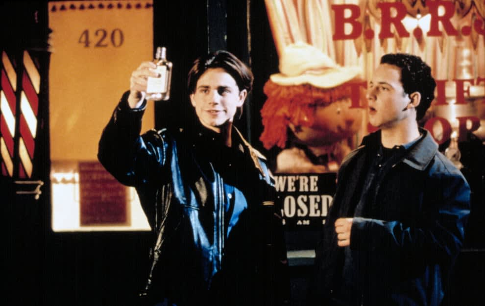 """Rider Strong wearing a leather jacket next to Ben Savage on """"Boy Meets World"""""""