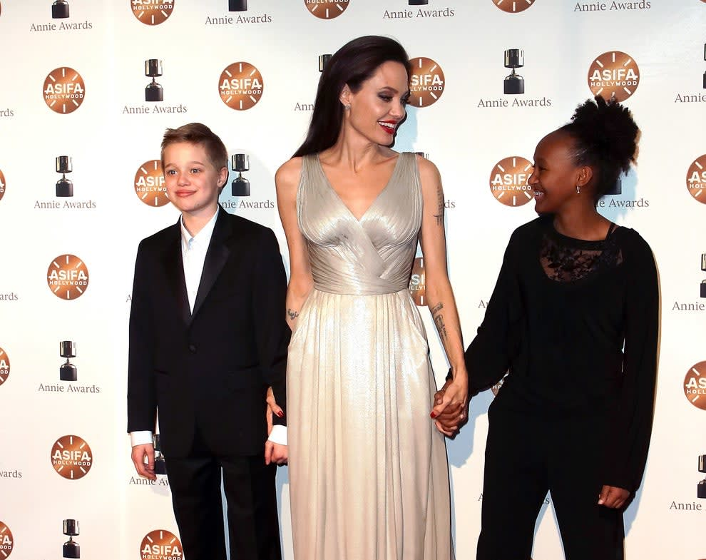 Shiloh Nouvel Jolie-Pitt, Angelina Jolie, and Zahara Marley Jolie-Pitt attend the 45th Annual Annie Awards at Royce Hall on February 3, 2018, in Los Angeles, California