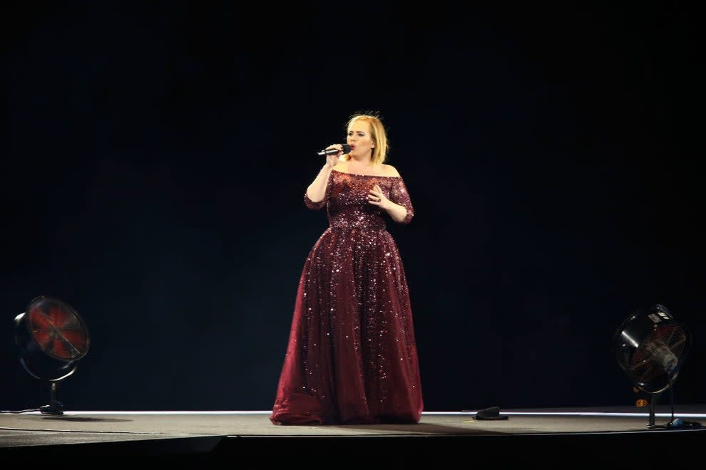 Adele performs in Australia in a floor-length gown