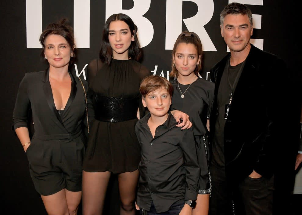 Dua Lipa with her immediate family at an event.